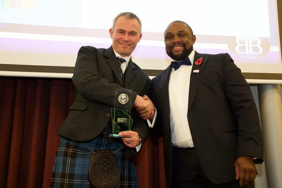 Matthew Dashper Hughes receiving Moderator of the Year
